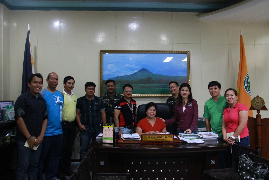 Ms. Jing Castañeda (3rd from right) together     with Dr. Maria Luisa R. Soliven, University President and some CMU officials     and representatives from the 4th Civil Military Operations Battalion 4ID     headed by Lt. Col Eugenio Julio Osias