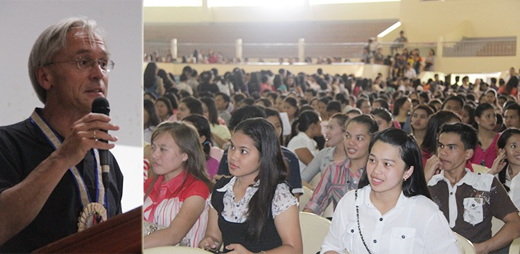 Students listen to Dr. Heinrich Geiger as he presents the KAAD scholarship grant.
