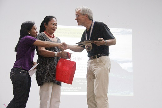 LTLO Head, Dr. Joy M. Jamago and OASP Head, Dr. Nenita C. Prado give the Certificate of Appreciation and token to Dr. Geiger.