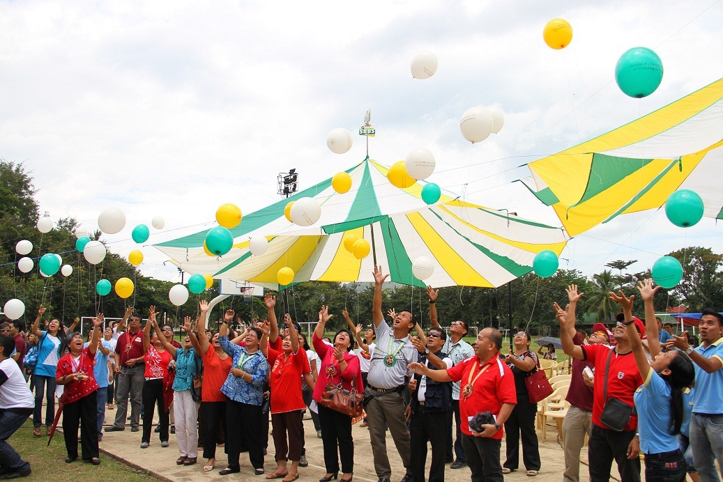 CMU officials, alumni, staff and students join  releasing of balloons.